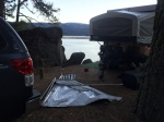 Our first view of the damage: awning on the ground, tent pole 8' up on the rock